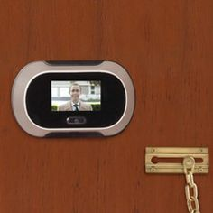 """Who is at my door!??? The ultimate peep hole! Lens provides a wide 96º view using same image sensor used by digital cameras. Image displayed on 2 1/2"""" screen."""