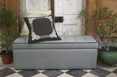 The sofa.com Buttons blanket box in Flint brushed linen cotton with grey velvet piping - starts at $680