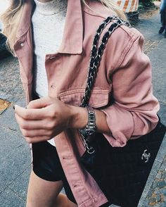 Pink denim jacket.