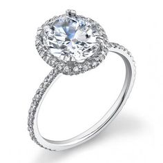 Engagement Envy: 20 Rings that Rock Our World | InStyle.com Both timeless and oh-so-current, this round brilliant center stone (price upon request; yanina-co.com) will suit many modern girls. The delicate engagement ring is set in18 karat white gold with a halo of pave set white diamonds.