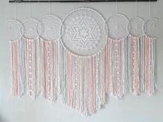 ooak dreamcatchers, dream catcher, home wall decor, boho home decor Dreamcatcher made by hand in very fine mercerized cotton yarn in colors of the rainbow feathers and beads measures 150 cm wide and 134 cm high (the branch is not sent) Dream Catcher White, Dream Catcher Boho, Dreamcatcher Crochet, Making Dream Catchers, Mercerized Cotton Yarn, Boho Wall Hanging, Macrame Projects, Home Wall Decor, Mandala