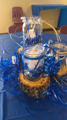 Center piece at banquet, pieces of wood cut about 2 inches, mason jars filled about 1/4 of the way with decorative stones add a battery operated light inside the jar, add garland or other decorative things around the jars.