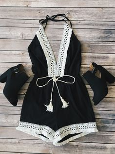 """Woven romper with crochet trim and plunging neckline. Fabric Content: 100% POLYESTER Small Description: L: 34"""" B: 12"""" W: 10"""" I.S: 3"""""""