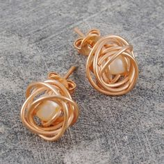 Caged Pearl Rose Gold Stud Earrings in White - A striking, contemporary design featuring exquisite and intricate craftsmanship where a single, white freshwater pearl is cleverly encased within a rose gold plated wire cage to produce these Caged Pearl Rose Gold Stud Earrings in White. #Otisjaxon #Jewellery #MothersDay #Present