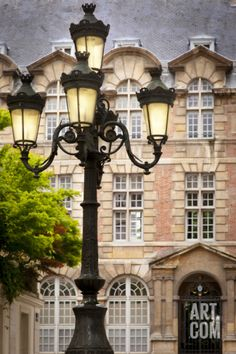 Lamppost in Place de Furstenberg with Institutudes Augustiniennes. Photographic Print by Brian Jannsen at Art.com