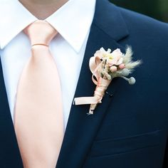 peach tie and boutonniere - what it looks like with navy.. hmm.