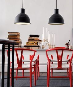 I'm obsessed with pops of red in design- these chairs are a perfect example. Also like the oversized hanging lamps