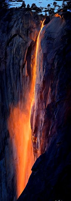 The lava pops out of the picture as its bright orange comes out from the black rocks.