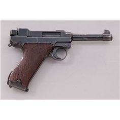 3rd Variation Lahti L-35 Semi-Automatic Pistol, #6682, 9mm, 4.7'' barrel, blue finish, brown checkered plastic grips with VKT logo, cut for shoulder stock, with rectangular Loaded Chamber indicator; later upper receiver marked ''VKT/L-35'' with yoke locking piece and protrusion and slide lightning cuts Loading that magazine is a pain! Get your Magazine speedloader today! http://www.amazon.com/shops/raeind