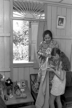 A daughter helping her mother to put up the curtains for Hari Raya Puasa, 3 November Singapore Photos, Dutch Colonial, Old Advertisements, Colonial Architecture, Pictures Of People, Old Photos, Nostalgia, Beautiful Pictures, The Past