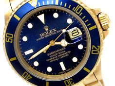 40mm Gents Rolex 18k Yellow Gold Submariner Watch. Style 16618. Blue Dial. Blue insert. Oyster Band. Style 16618.   Metal:  YELLOW GOLD  Order Item:  31615  Style:  SUBMARINER  Gender:  GENTS  Band:  18YG OYSTER  Dial:  BLUE  Bezel:  BLUE  Crystal:  SAPPHIRE  Movement:  AUTO  List Price:  $34,250  Our Price: call for price