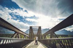 Engine bridge blue skies wide angle shot Canmore Quarry Lake engagement session by Calgary wedding photographer Anna Michalska
