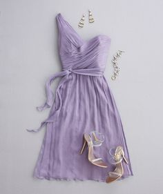 Lavender dress with one-shoulder neckline, strappy heels, and silver jewelry