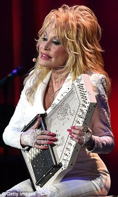 Multitalented: Dolly showed off her wide range of skills as she continued to swap out inst...
