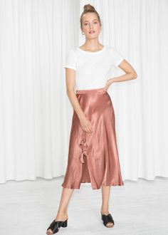 Model front image of Stories duo bow slit midi skirt in red