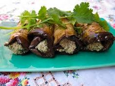 Slice small eggplants lengthwise into 1/2 in slices, salt, drain, fry slices in a pan till golden brown on each side and let cool. Smother one side with a mixture of minced walnuts, garlic, parsley and a bit of mayo. Roll them up, chill and enjoy! They are heavenly! (if you got a very large eggplant, you can slice it in circles)