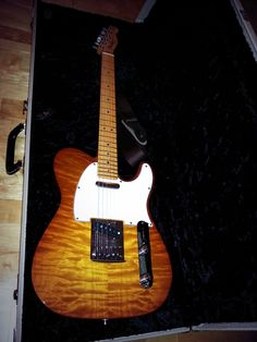 #Fender #CustomShop #Telecaster Custom Deluxe 2012. Faded Honey Burst, AAA quilted maple top. Sounds as good as it looks.