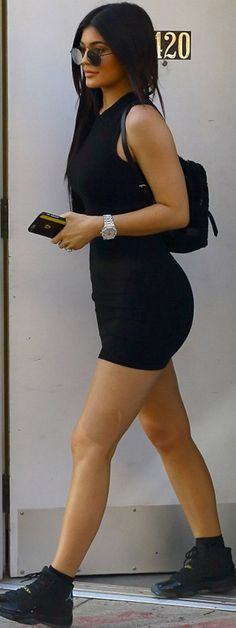 Who made  Kylie Jenner's black dress, sunglasses, sneakers, and backpack?