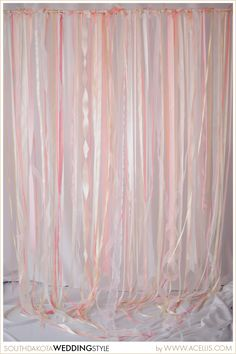 This ribbon backdrop/curtain can be used at an entrance to walk through, behind a sweetheart table or cake table, or even as your photobooth background. Choose your colors and style of ribbon based on your wedding style.