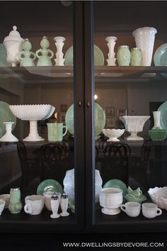 milk glass and jadeite displayed on black hutch. gorgeous, Nice mix of modern and vintage!