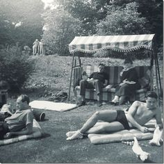 1930s: In an original Idler Garden swing – Beaton and his friends sunbathe at Ashcombe.
