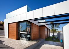 Holiday destination, winter home or permanent residence, at SolSpainGroup you will always find the perfect property to fulfill your wishes. Composite Cladding, Permanent Residence, Exterior Cladding, Winter House, New Builds, Minimalist Home, Exterior Design, Garage Doors, Villa