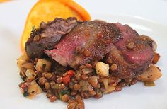 Wild duck breast and mushrooms with orange sauce