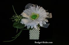 6 wrist corsages with 1 gerber daisy with white organza ribbon and simpler greens.