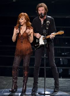 "Reba McEntire Photos Photos - Recording artists Reba McEntire (L) and Ronnie Dunn perform during the opening weekend of their residency ""Reba, Brooks & Dunn: Together in Vegas"" with Kix Brooks (not pictured) at The Colosseum at Caesars Palace on June 19, 2015 in Las Vegas, Nevada. - 'Reba, Brooks & Dunn: Together In Vegas' Opening Weekend at Caesars Palace"
