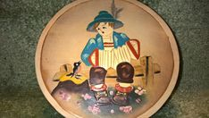 Vintage Wooden Plate  Boy with Accordian by RobandJensOddsnEnds