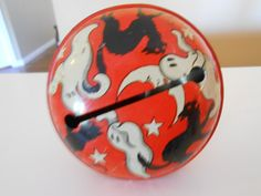 Vintage Halloween Tin Litho Noise Maker with red wood handle. Works
