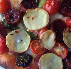 Go toppings-crazy at your next #pizza #party! Chorizo, cherry tomatoes, broccoli rabe, and thinly-sliced potatoes make one happy family
