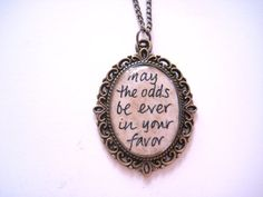 """Four Left! The Hunger Games Quote Hand Painted Necklace by loveandwhiskers, $20.00.  """"May the odds be ever in your favor"""""""