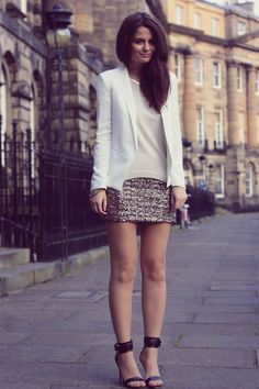 love the curve hemline on her sweater