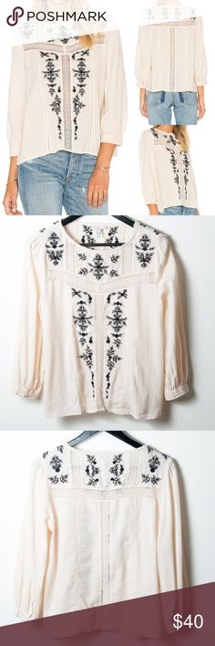 Joie Oakes Embroidered Blouse Almond Caviar Small Size small Joie blouse. Colors are listed as almond and caviar - a cream and black. Lace trim and embroidery thought. A light and airy blouse with peasant charm is cut from crinkled cotton gauze detailed with insets of delicate lace and sprigs of black embroidery. Jewel neck, long sleeves (but not to wrist) with double button and loop cuffs. Semi sheer. Great preloved condition. No noticeable stains holes or rips. Joie Tops Blouses