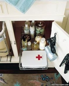 11 essential bathroom organizers that get the job done.: Create a labeled First Aid kit so anyone can easily spot the kit.