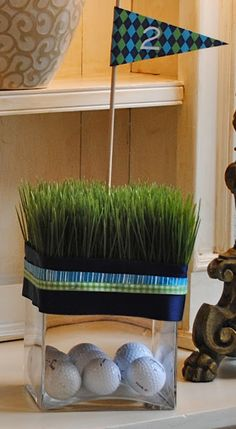 Simple centerpieces- such a good idea for something celebrating a golfer guy!