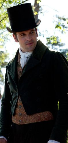 Jonny Lee Miller wearing a top hat in adaptation of Emma.