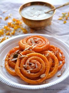 Learn step by step instant jalebi recipe with yeast. Instant jalebi is a delicious, crunchy and melt in mouth spiral pancakes soaked in saffron syrup. Indian Desserts, Indian Sweets, Indian Food Recipes, Vegetarian Recipes, Cooking Recipes, Indian Foods, Recipes With Yeast, Delicious Desserts, Gourmet