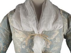Detail front view, robe à l'Anglaise, Great Britain, 1745-1750. Pale blue silk damask brocaded with silver floral motifs and leaves.