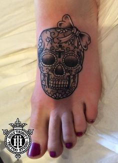 Sugar skull on the foot tattooed at Holy trinity tattoos by Nathan