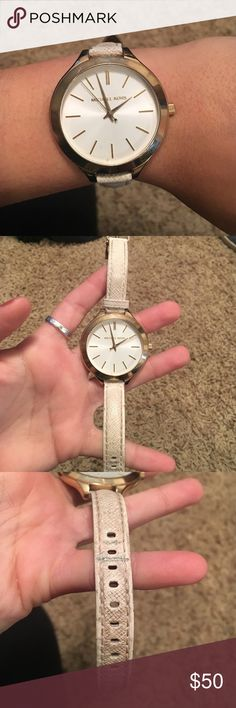 Michael Kors watch Michael Kors watch. White band is worn and discolored. Watch works perfect and when on the wrist can barely see the wear on the band KORS Michael Kors Accessories Watches
