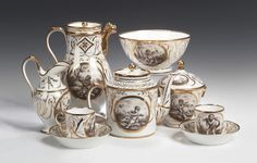 lot257 A Paris Empire porcelain coffee service, the cartouche painted en grisaille depicting putti at various rural pursuits and surmounted by ornate gilt acanthus scrolls and borders comprising: twelve coffee cans, twelve saucers, coffee pot with lions mask spout, tea pot of cylindrical shape, sugar bowl and cvoer, milk jug and slop bowl