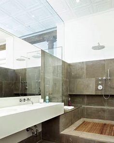 Solution to our problem! Brilliant! the master bath with its large convertible tub/shower, where a teak slat floor can be removed to reveal a large soaking bathtub.