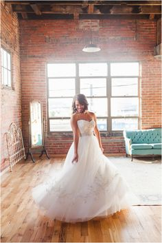 Bride spinnig in her wedding dress click to view more
