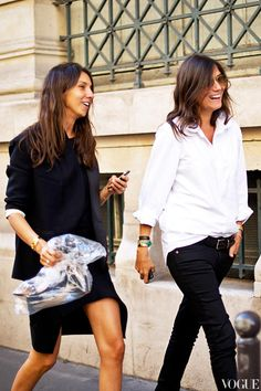 White shirt half tucked into dark pants with bracelets...love...Team Vogue Paris