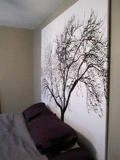 I love this! There are some really awesome shower curtains out there! Staple a shower curtain to a wooden frame for inexpensive large scale artwork.