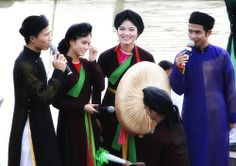 The áo tứ thân is considered one of Vietnam's enduring relics, having been worn widely by women centuries before the Áo Dài. As Vietnam expanded southward, Áo Tứ Thân gradually became associated specifically with northern women.The áo tứ thân was the dress of peasant women, which explains why it was often made with plain fabric in dark colors, except when it was to be worn at special occasions such as festivals or weddings.