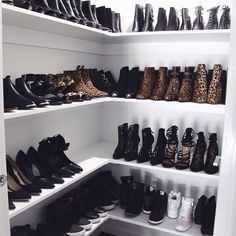 HOLY SHOES! We love this shoe closet with all these heels, sneakers and boots.