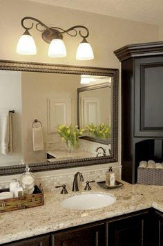 this is what I had in mind for the oil rubbed bronze light fixture and taps. Works great with espresso cabinets and mirror frame! - Model Home Interior Design Bad Inspiration, Bathroom Inspiration, Diy Bathroom, Bathroom Ideas, Bathroom Cabinets, Bathroom Vanities, Bath Ideas, Small Bathroom, Bathroom Organization